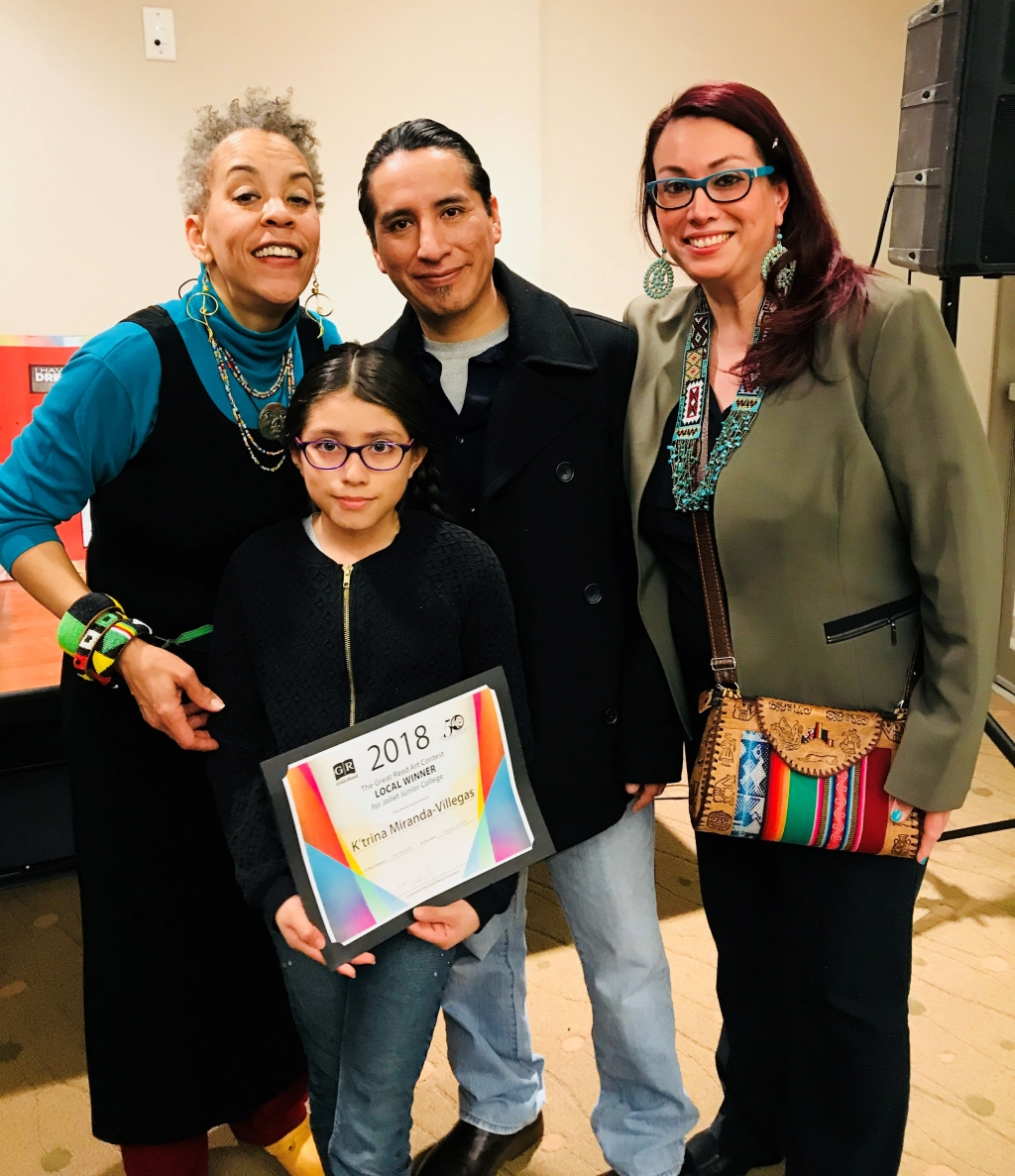 Musician Maggie Brown with JJC art contest winner K'trina Miranda Villegas and her family.