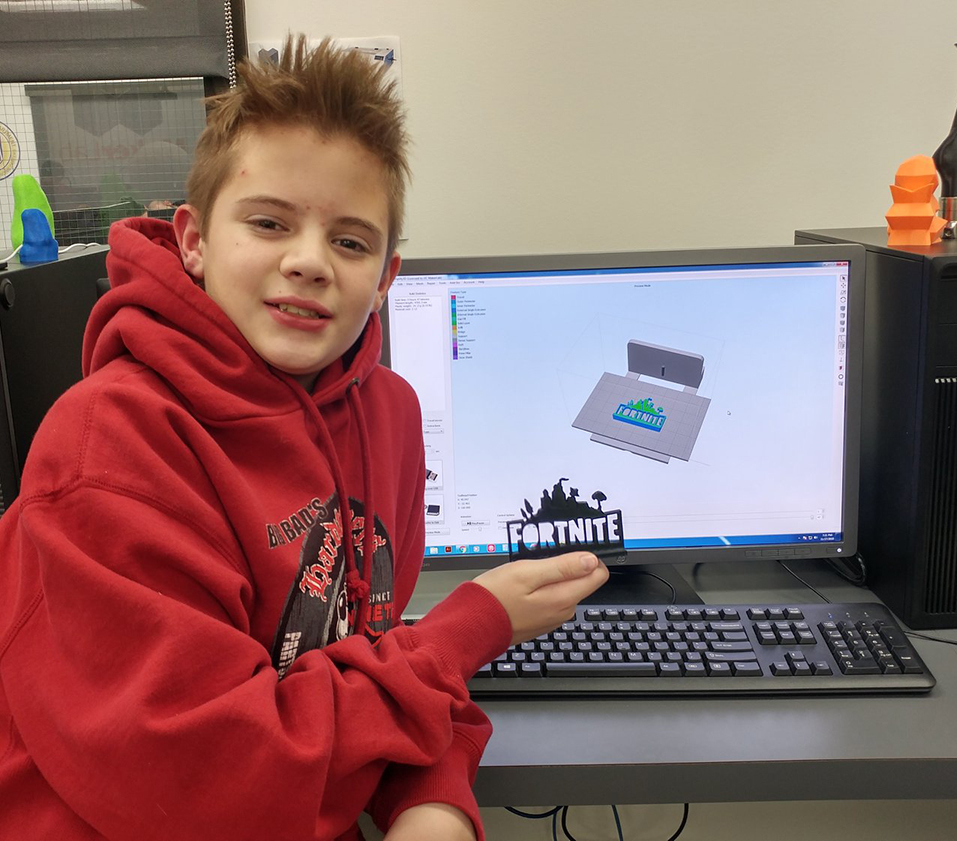 student with 3-D printed object