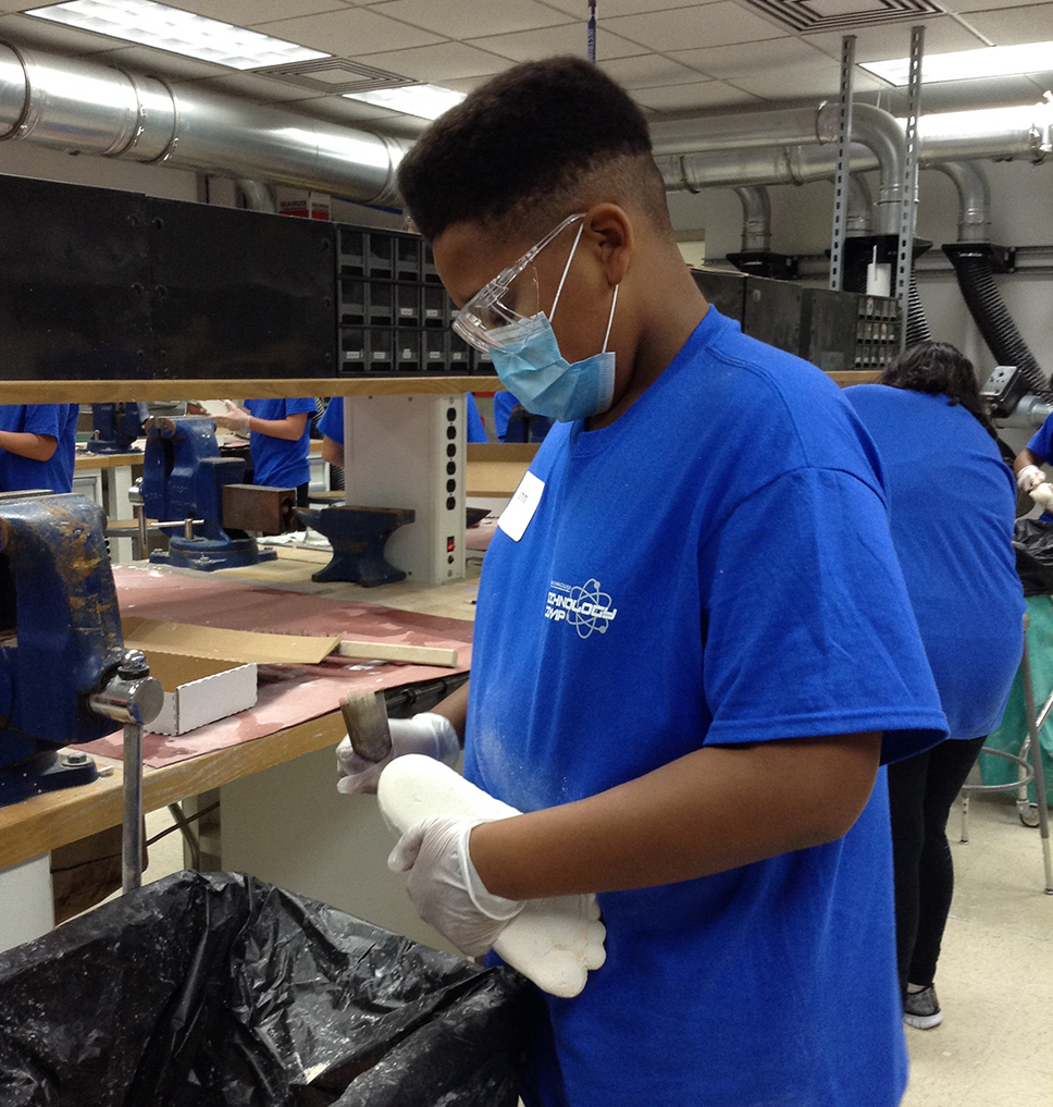 student taking a mold for a prosthesis