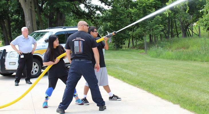 students using fire hose