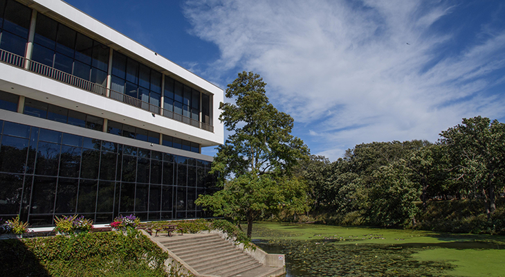 JJC building overlooking the natural landscape of campus.